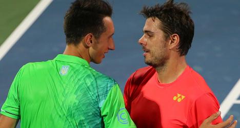 Wawrinka battles back to win first match in Dubai