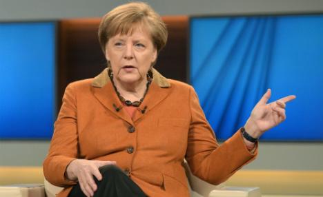 'I will do my damn duty' on refugees, says Merkel