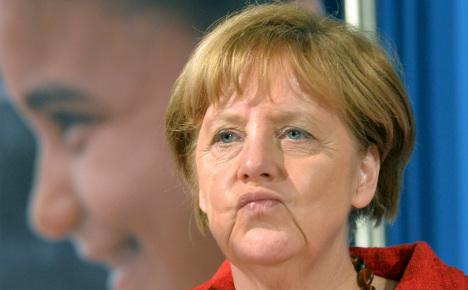 Merkel accused of cynicism on refugee route closure