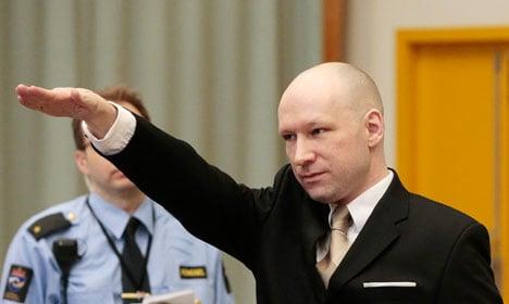 Breivik makes Nazi salute as civil trial begins