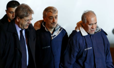 Freed hostages return to Italy from Libya