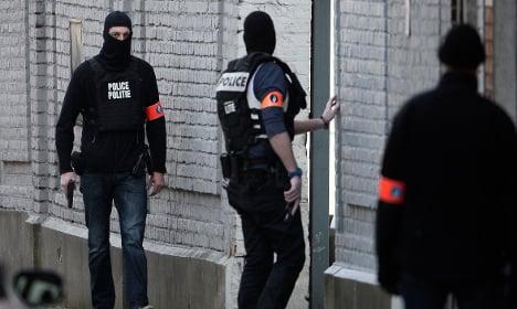 Gunman killed in Brussels raid 'had role in Paris attacks'