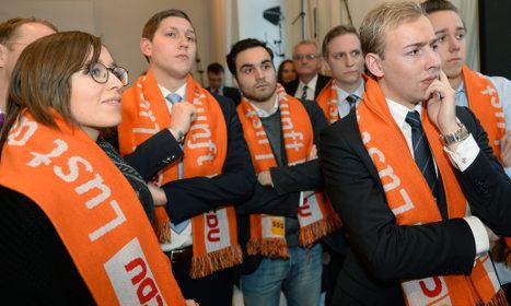 Merkel's CDU party loses two of three regions: exit polls