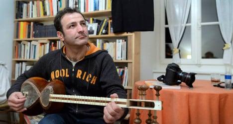 Swiss photographers help expelled refugee