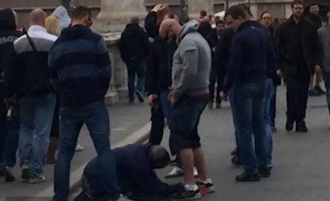 Prague football fans filmed urinating on Rome beggar