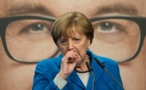 Voters set to punish Merkel at key 'Super Sunday' election