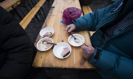 Swedes cheer immigrant worker helping homeless