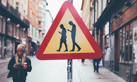 How Sweden's fake 'smombie' sign is being used for real