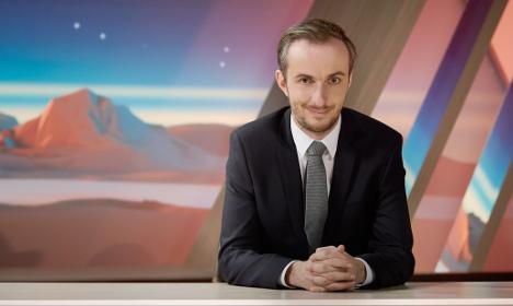 German comic in Erdogan satire row suspends TV show