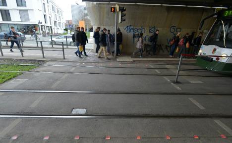 City installs floor traffic lights for smartphone addicts