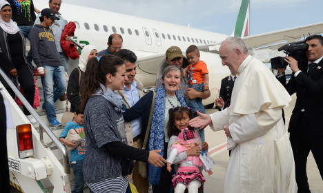 Pope Francis takes 12 refugees back to Vatican
