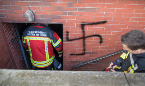 Refugee admits to swastika arson attack