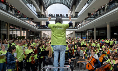 Berlin mall occupied by 1,000-strong 'flashmob orchestra'