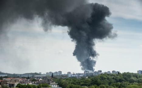 Explosions heard as fire rips through Berlin supermarket