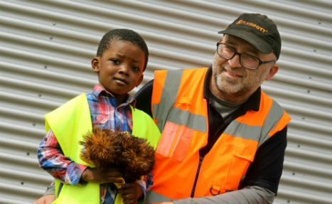 Hero bin man saves child from 2nd storey plunge