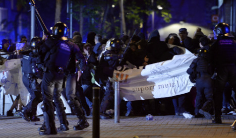 Squatters clash with police over Barcelona bank eviction