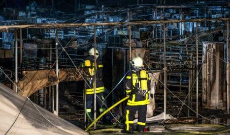 Dozens saved as huge refugee home burns to ground