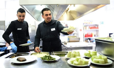 Germany puts refugees to work … for one euro