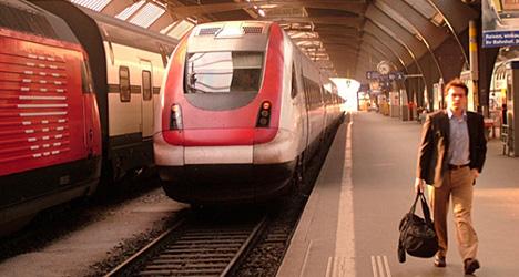 Suspected arson attack closes train line to Zurich airport