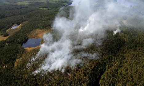 Crews battle wildfires blazing through Sweden