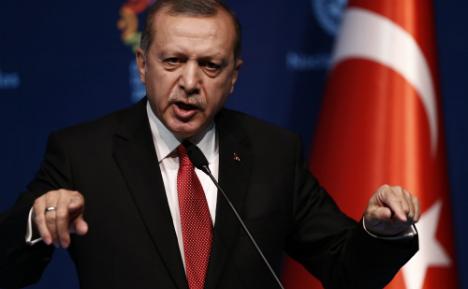 German MPs file war crimes suit against Erdogan