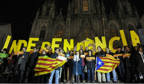 Catalan parliament defies court in independence drive