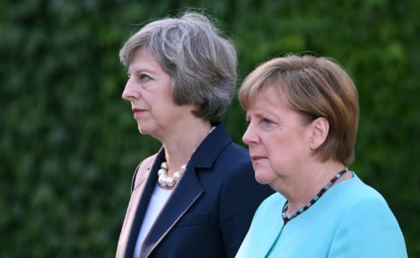 Merkel accepts UK's decision to delay triggering Brexit