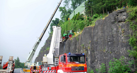 Terror as tractor tumbles towards Swiss motorway