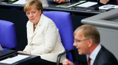 Brexit, budget keep Merkel away from football