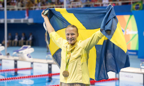 Swede breaks world record to claim Olympic swimming gold