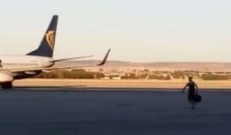 Desperate Ryanair passenger chases after missed flight