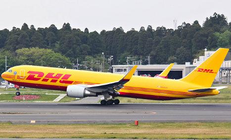 Cargo jet slides onto road after overshooting runway
