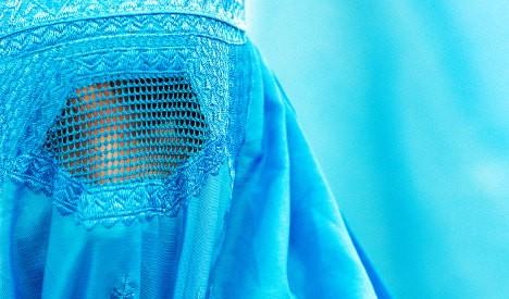 Interior minister proposes partial burqa ban