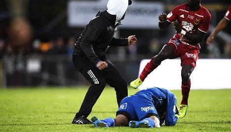 Swedish match abandoned as fan attacks goalkeeper