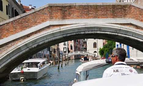 Three injured as Venice water taxi slices boat in two