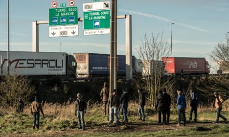 Migrants armed with sticks hold up truck driver in Calais