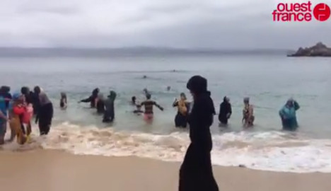 Bretons bathe fully clothed as Muslim asked to leave beach