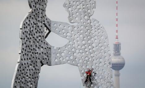 How did this bike end up on top of Berlin's Molecule Man?