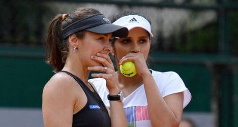 Hingis splits with winning doubles partner