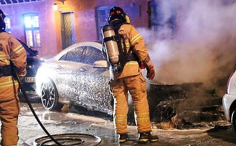 Copenhagen police arrest teen as car fires continue
