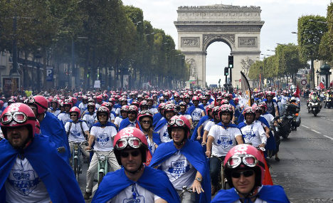 French bosses take to mopeds in 'anti-gloom' demo
