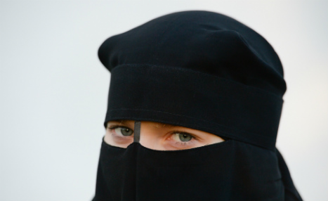 Restaurant suffers backlash for throwing out veiled woman