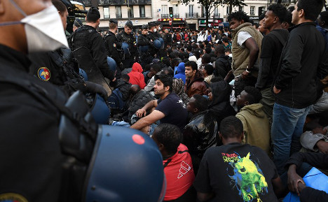 Paris police clear 1,500 migrants from makeshift camp