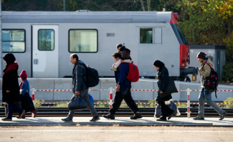 890,000 refugees arrived in Germany last year – not 1.1m