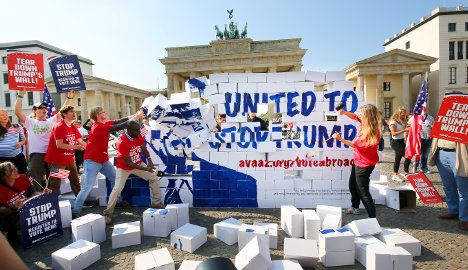 Trump protesters rebuild and tear down 'Berlin Wall'