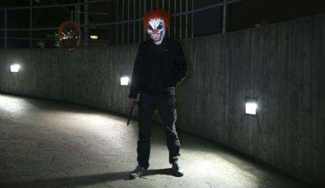 Axe-wielding clown chases Dane as craze spreads