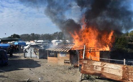 Jungle shacks set ablaze and torn down as camp razed