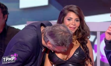 Anger after presenter kisses woman's breasts on live TV