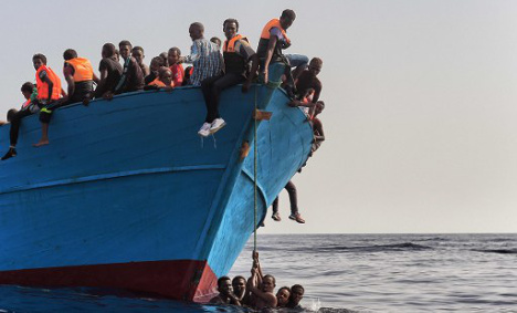 Armed men attack migrant boat, killing at least four