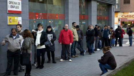 Spain jobless drops below 20% for first time in six years